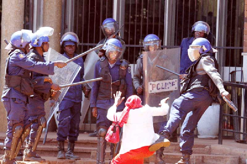 ZRP Riot Officers Brutally Assault Old Woman