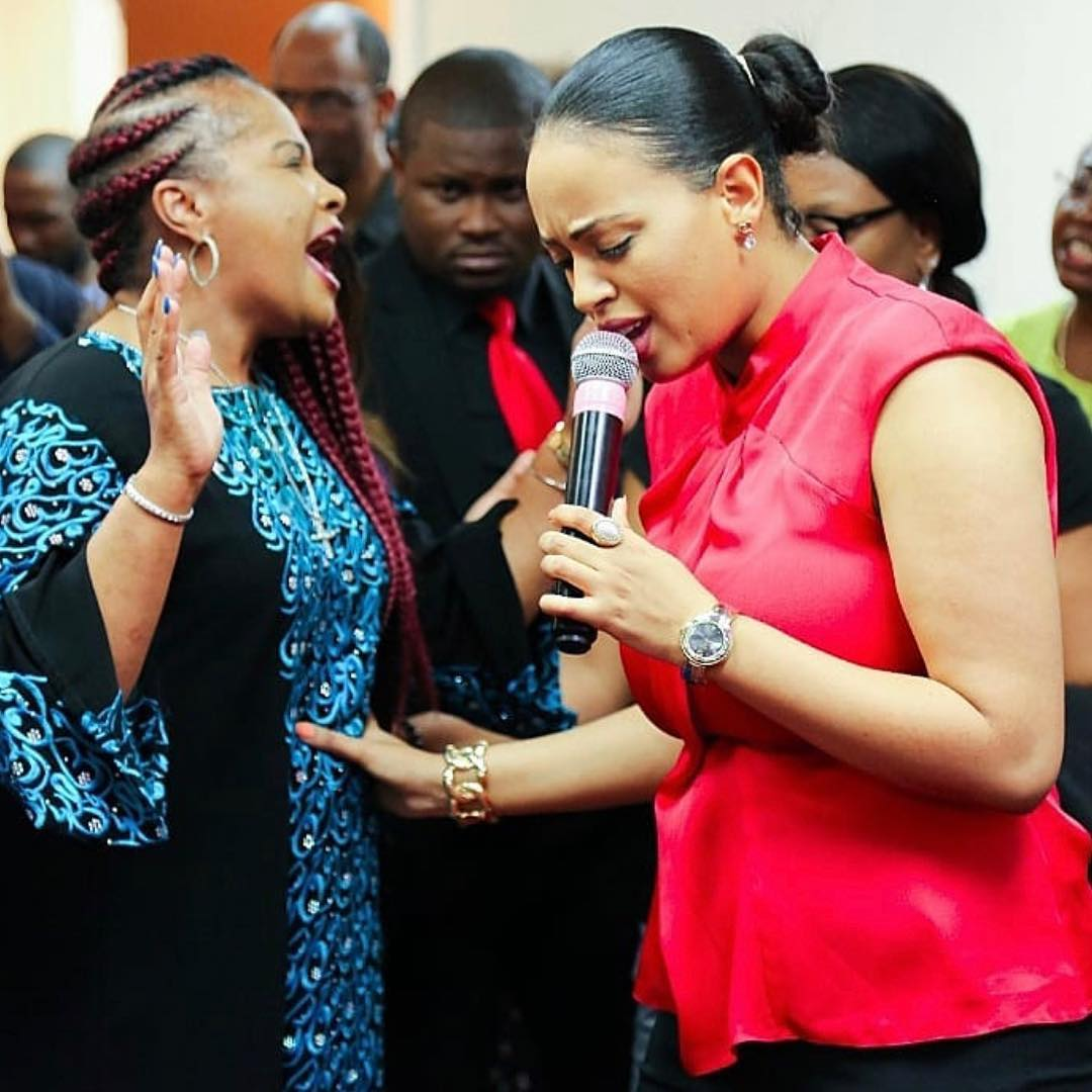 Lily Java, Passion Java's wife praying for congregant