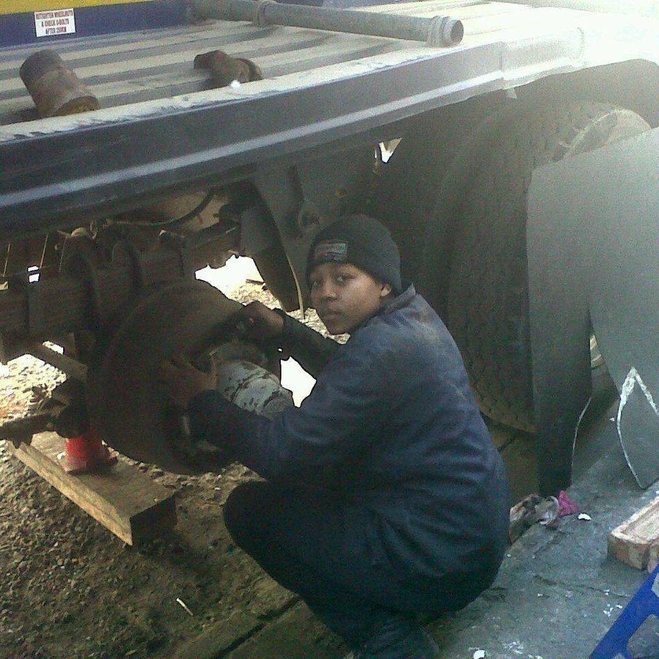 Memory Bere Zimbabwe female mechanic fixing a truck
