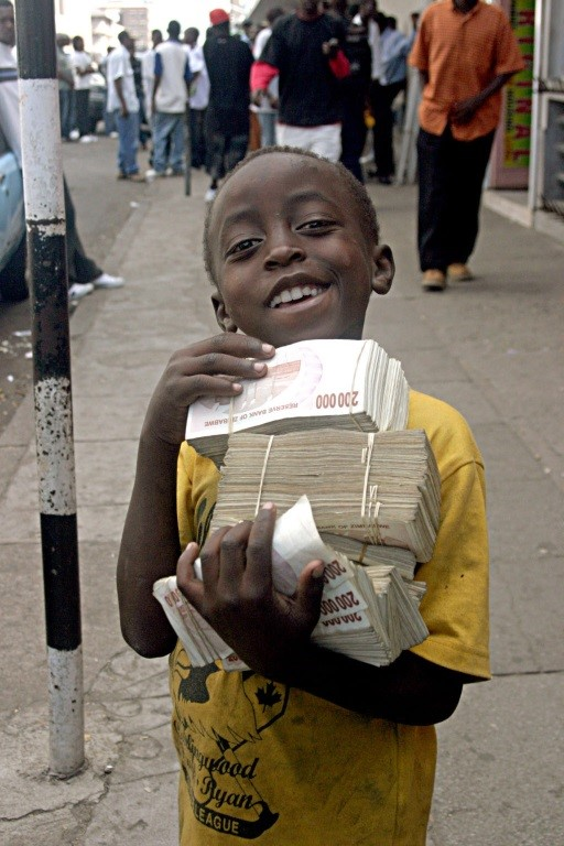 A Zimbabwean boy carrying huge amounts of cash eleven years later.