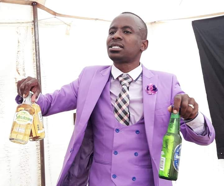 South African Pastor Prophet Ruffus Phala bringing out the beer