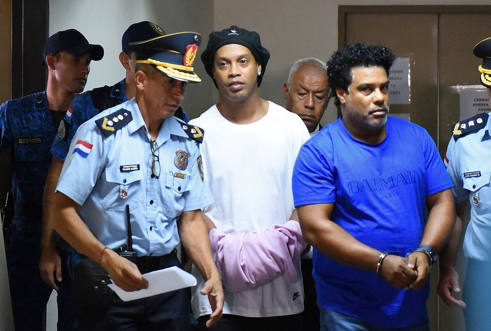 Former Brazilian football star Ronaldinho arrested in Paraguay over fake passport claims